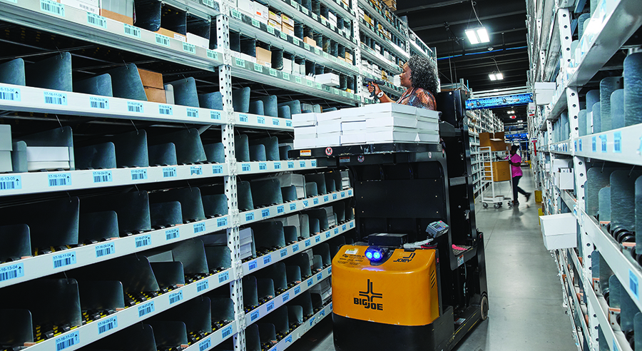 b233de3e94 An associate scans a putaway location as part of the receiving process.  Given the size of the products