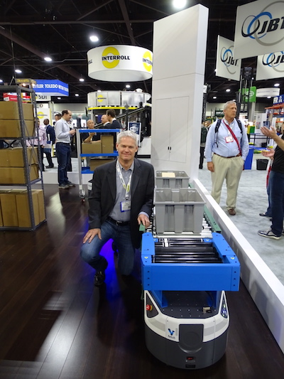 <p>Fetch Robotics COO Carl Showalter with Fetch's new RollerTop robot, which can hand off or receive from fixed conveyors.</p>
