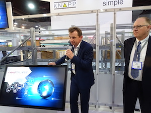 <p>Heimo Robosch, executive VP of Knapp, explained benefits of the new OSR Shuttle EVO Monday as Kevin Reader of Knapp (at right) looked on.</p>
