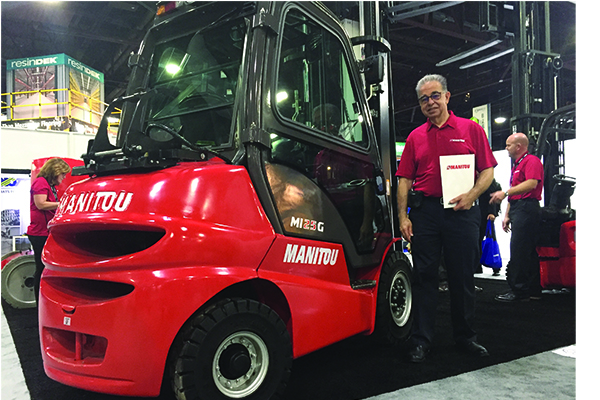 <p>Jean-Pierre Guérand, VP of global industrial sales, with a newly available newly available IC pneumatic forklift.</p>