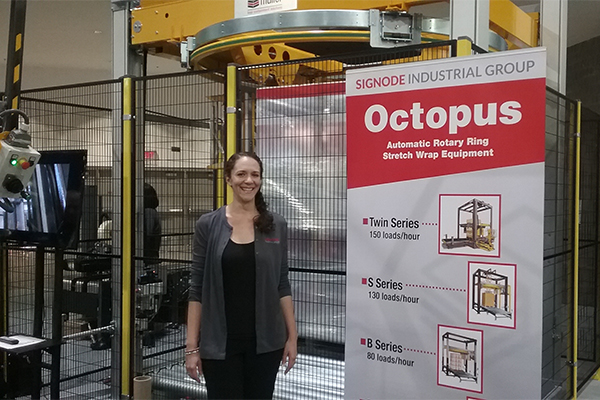 <p>Simona Georgescu, marketing manager for Signode Industrial Group, showcases Muller&#8217;s Octopus 1717C, an automatic rotary ring stretch wrapper.</p>